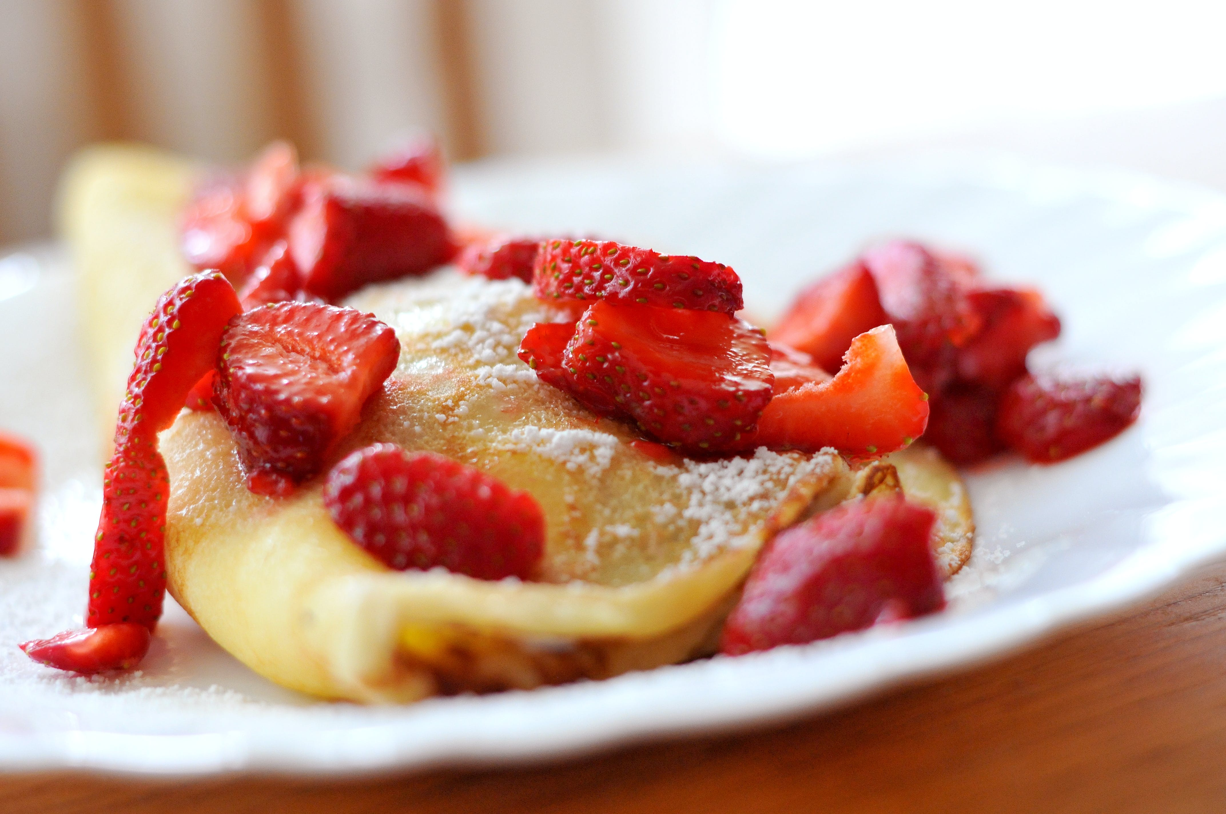 Crepe With Sliced Strawberries on Plate