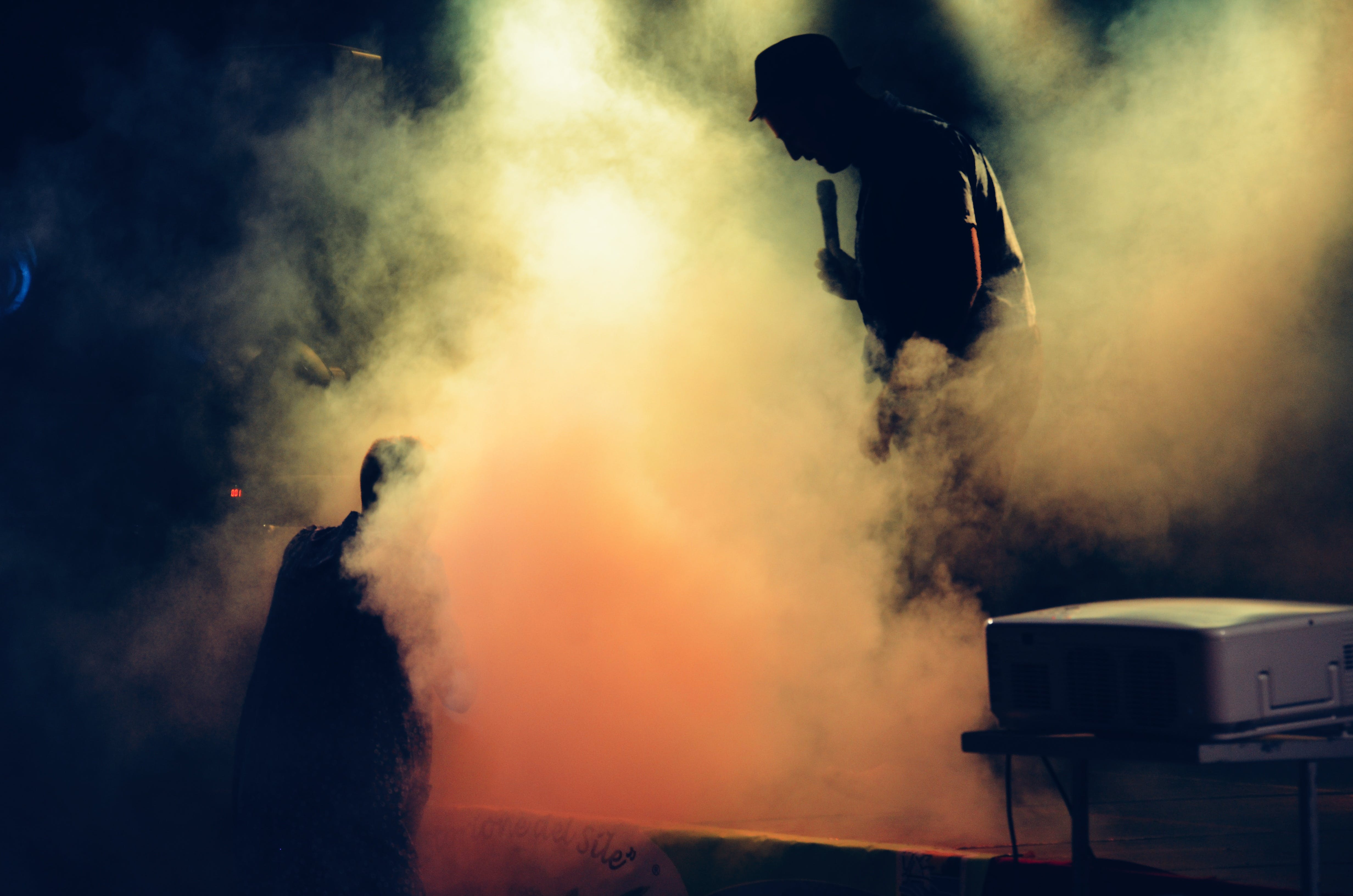 Man Holding Microphone at the Stage