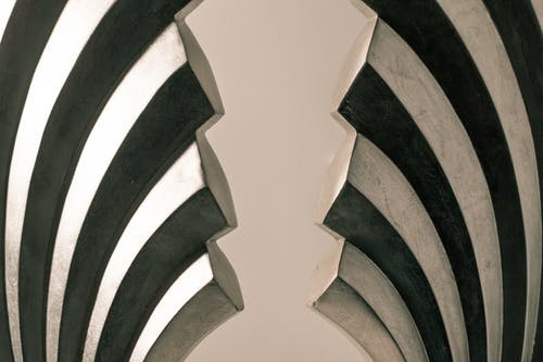Gray and Black Steel Wall Decoration on White Surface