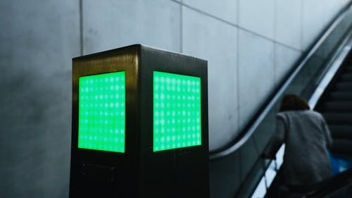 Free stock photo of elevator, green, green sign, railway station