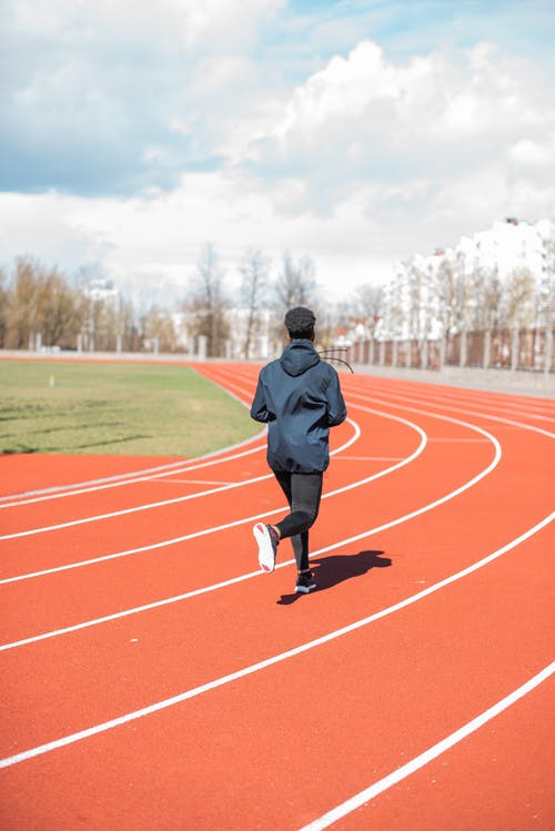 Person Running on Track