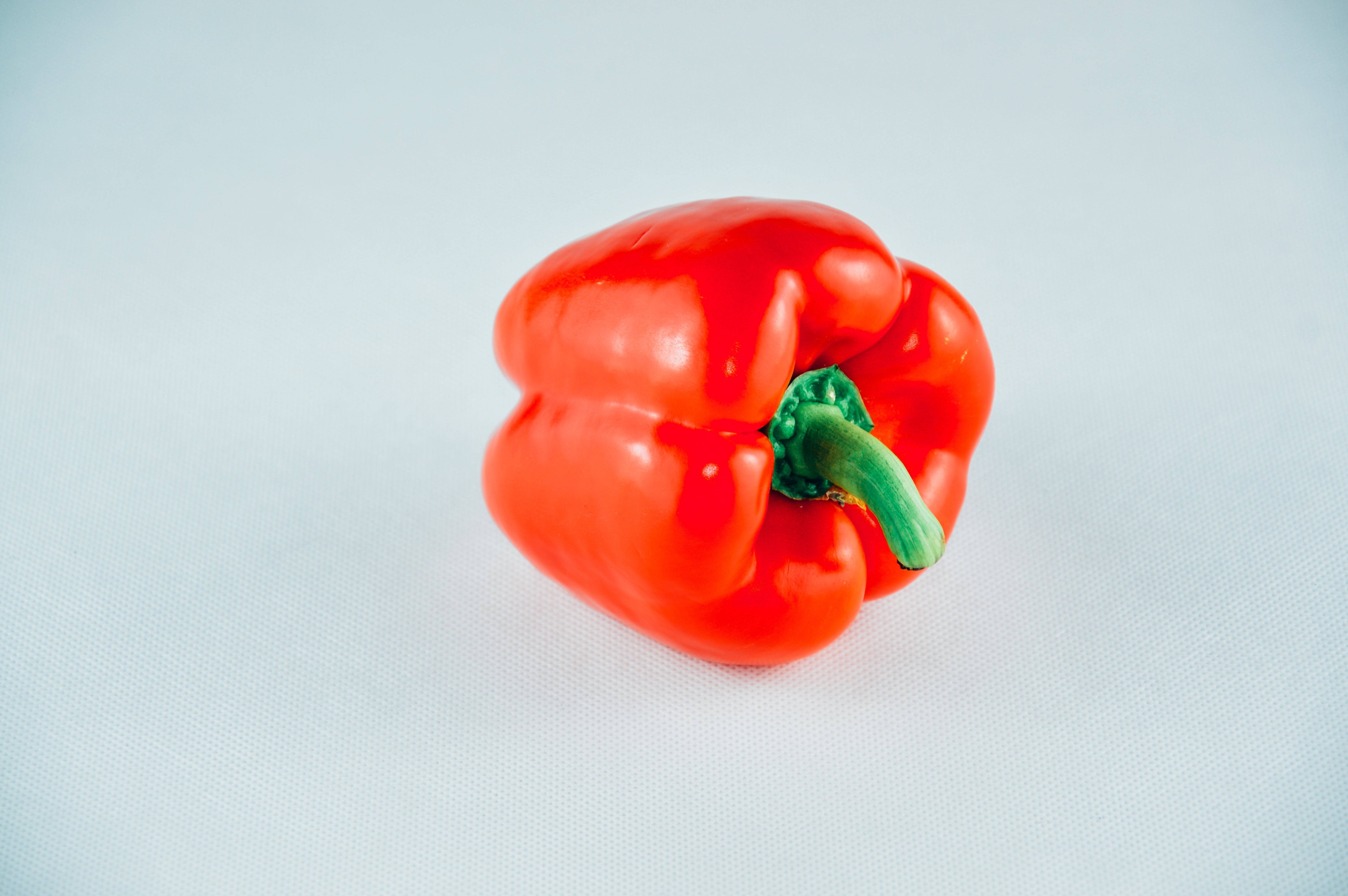Red Bell Pepper on White Surface