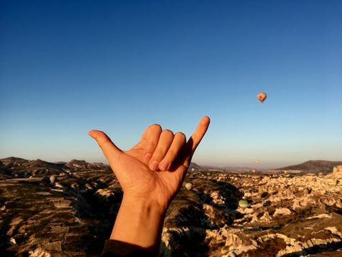 Free stock photo of blue sky, earth, hand, hot air balloon