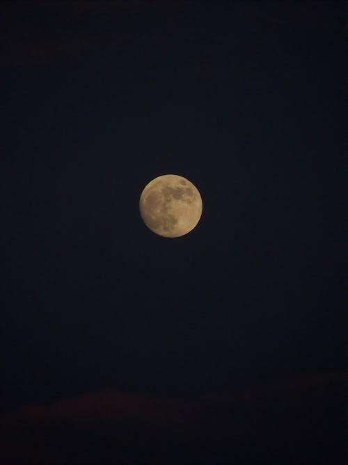 Moon illuminating on dark night sky
