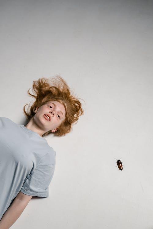 A Fearful Woman Lying Down Having a Katsaridaphobia