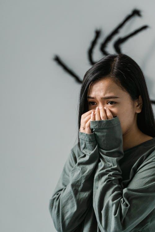 A Fearful Woman Having Arachnophobia