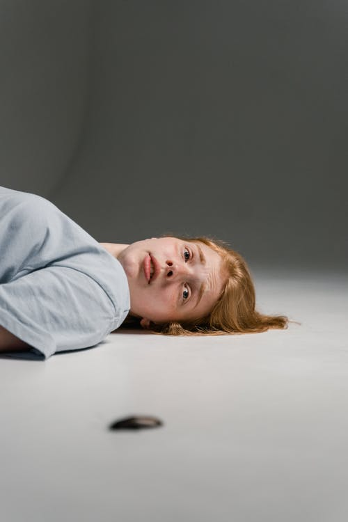 A Fearful Woman Lying Down