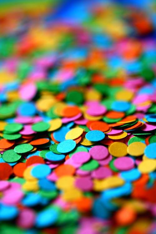 Selective Focus Photo of Colorful Circle Confetti
