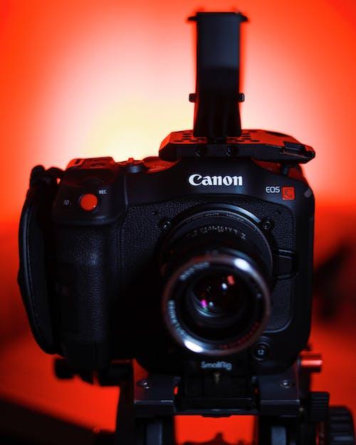 Black Nikon Dslr Camera on Orange Surface