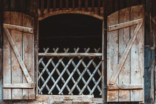 Brown Wooden Door With Black Metal Gate