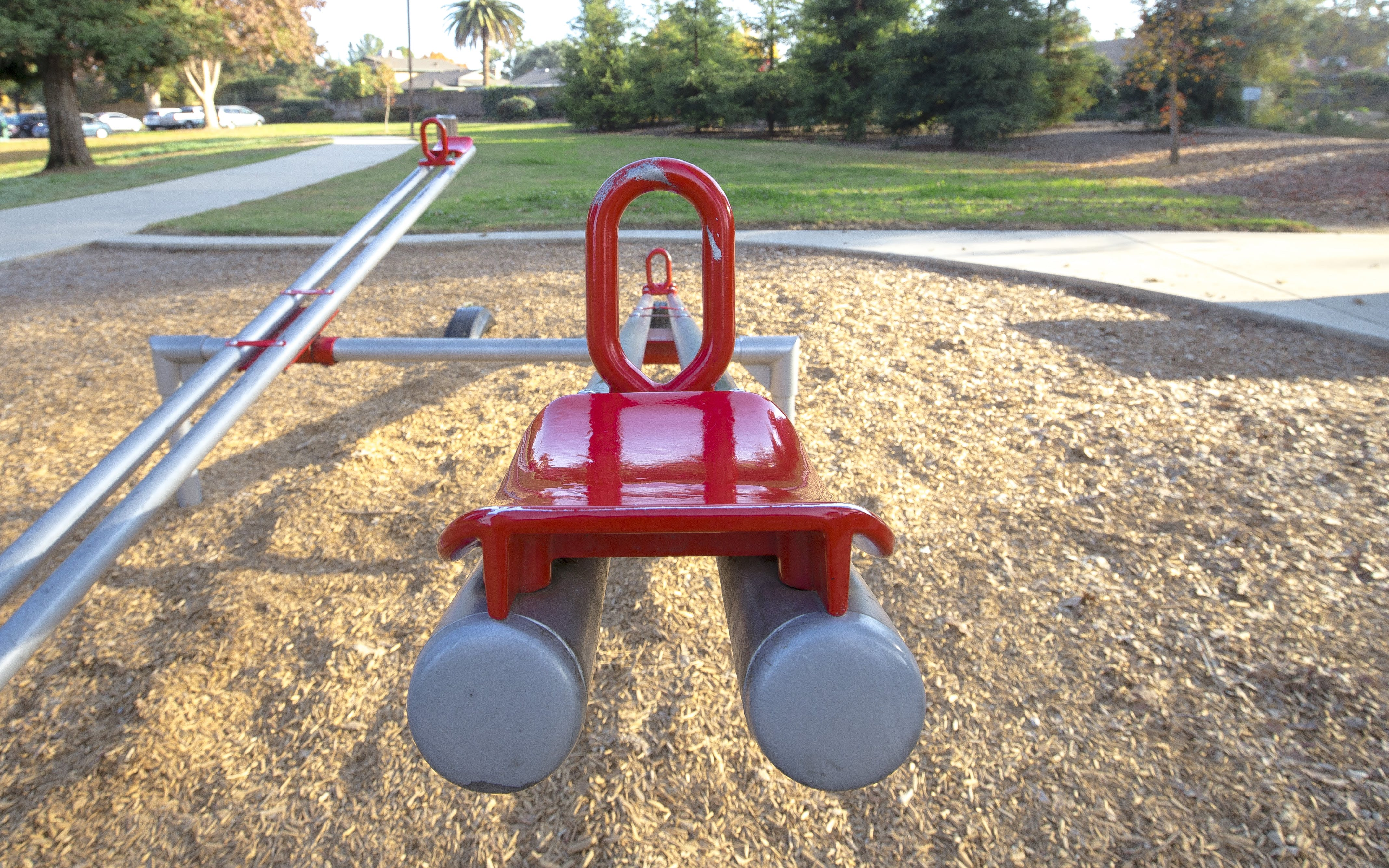 Red and Gray Seesaw in the Playground