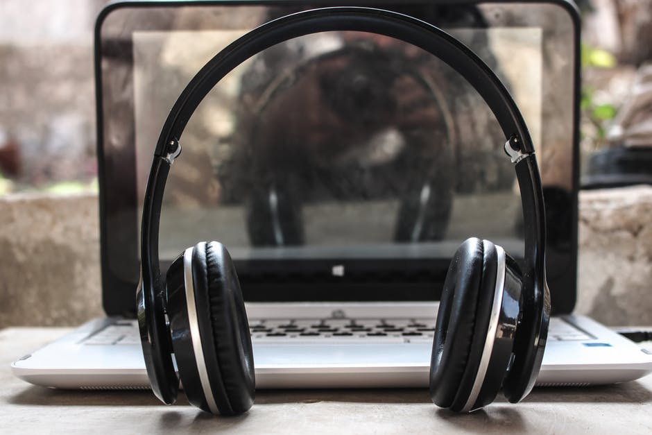 Photo of Black Wireless Headphones in Front of the Laptop