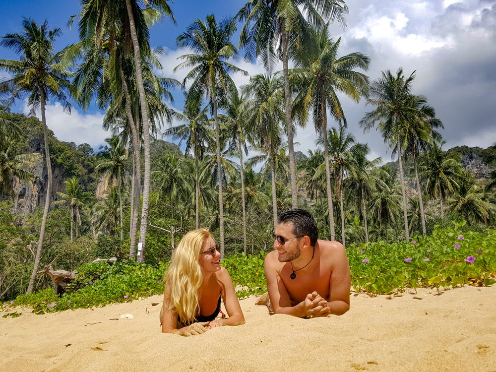 Man and Woman Lying on Sand