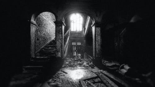 Monochrome Photo of Interior of an Abandoned House