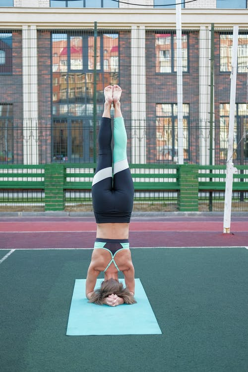 A Woman Doing Yoga Exercise