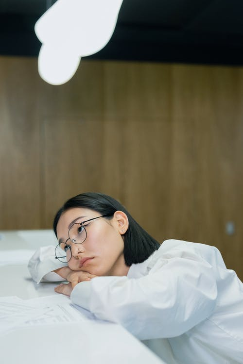 Woman Leaning her Head on Counter Top