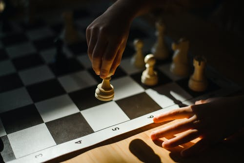 Close-Up Shot of a Person Playing Chess