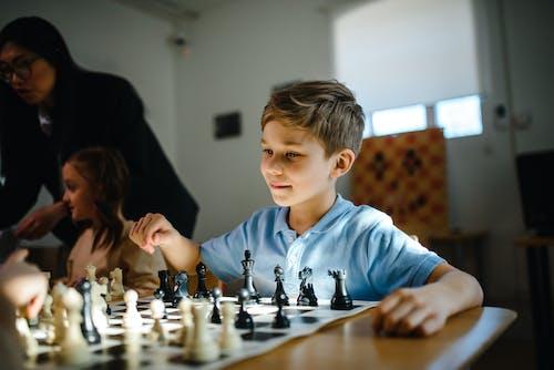 Boy Sitting Playing Chess