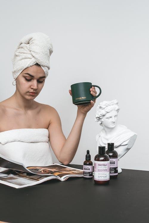Woman Holding Green Ceramic Mug