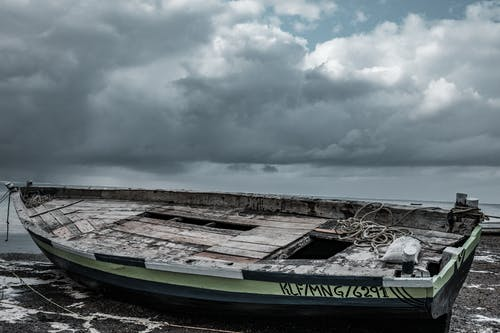 Abandoned Boat Docked in the Seashore