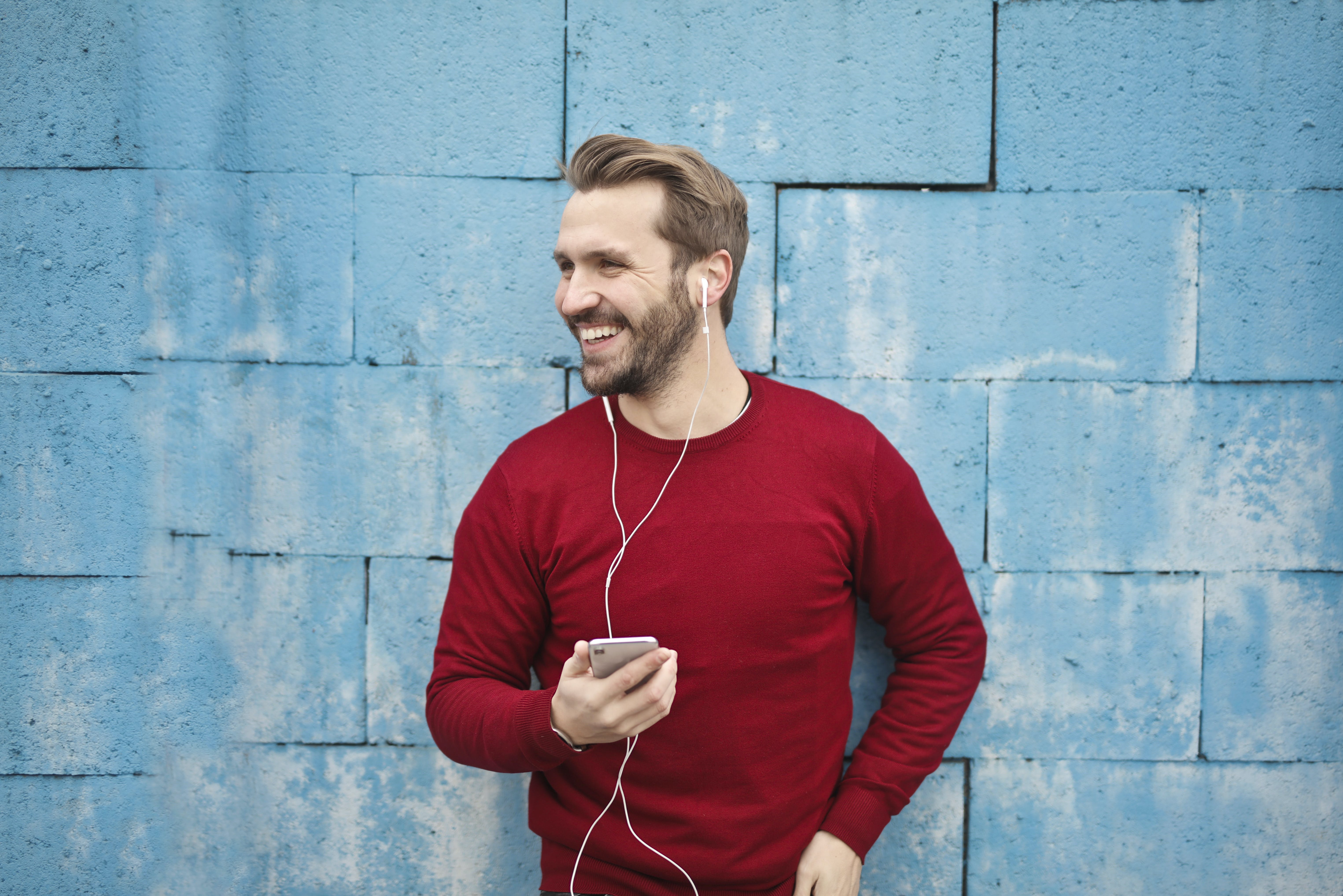 Photo of a Man Listening Music on his Phone
