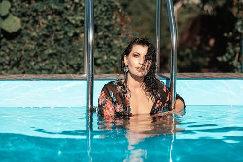 Woman In Pool By the Handrails
