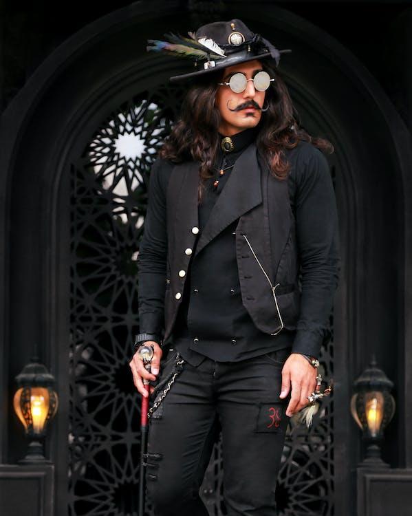 Woman in Black Suit Jacket and Black Pants Wearing Black Sunglasses