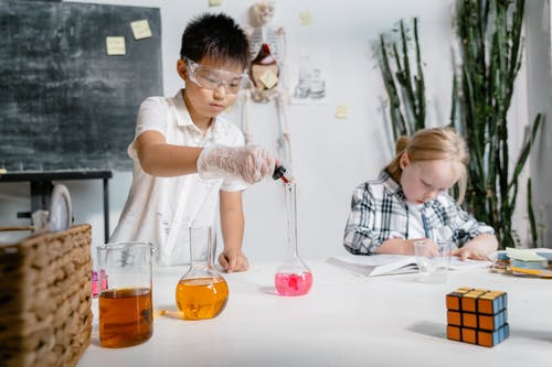 Students Experimenting Using Laboratory Equipment Inside the Laboratory