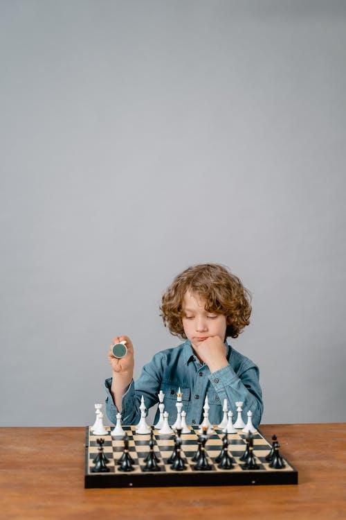 A Smart Boy Playing Chess