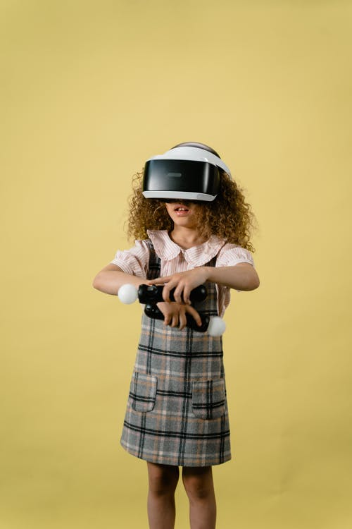 A Girl Playing in a Virtual Reality on Yellow Background