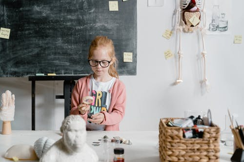A Smart Girl Doing an Experiment Inside the Laboratory