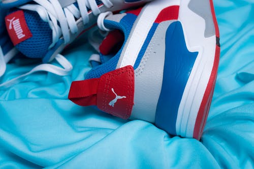 Pair of colorful sneakers on blue fabric