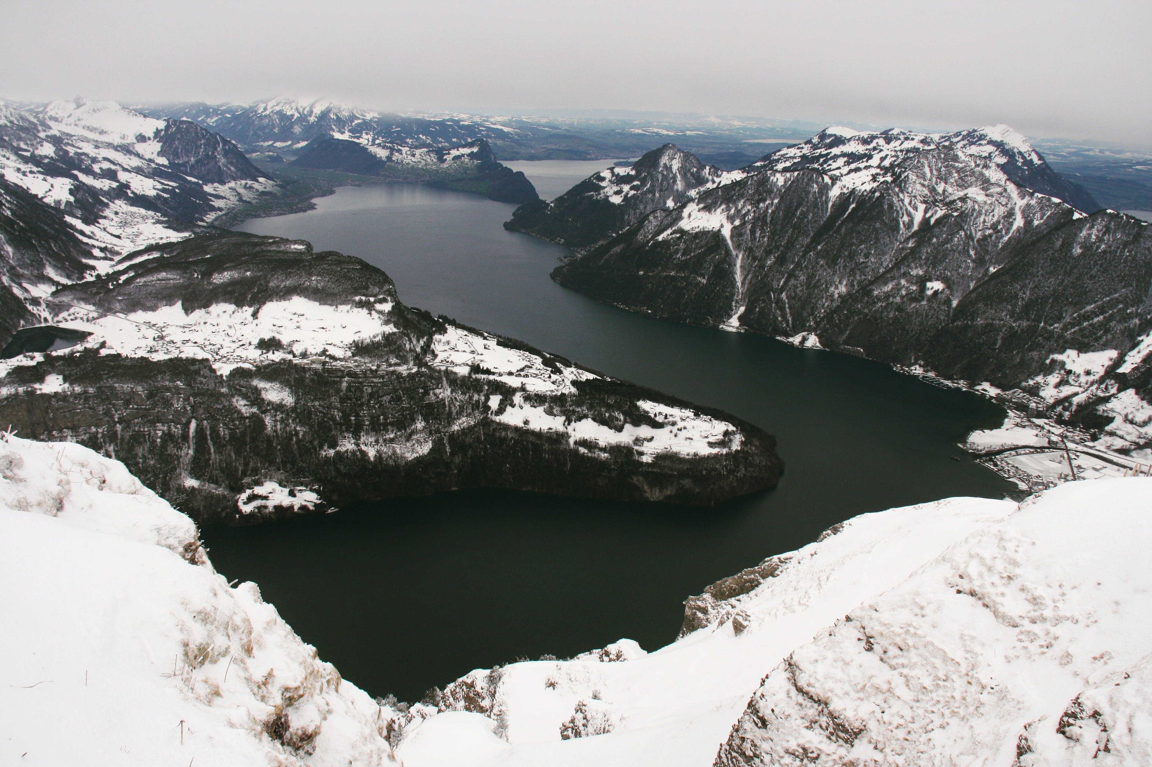 Islands With Snow Near Body of Water