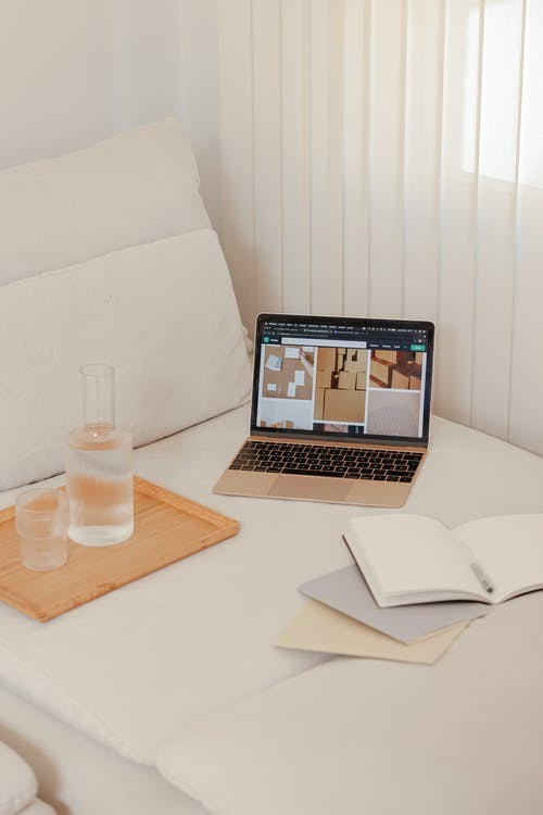 A Macbook on White Linen