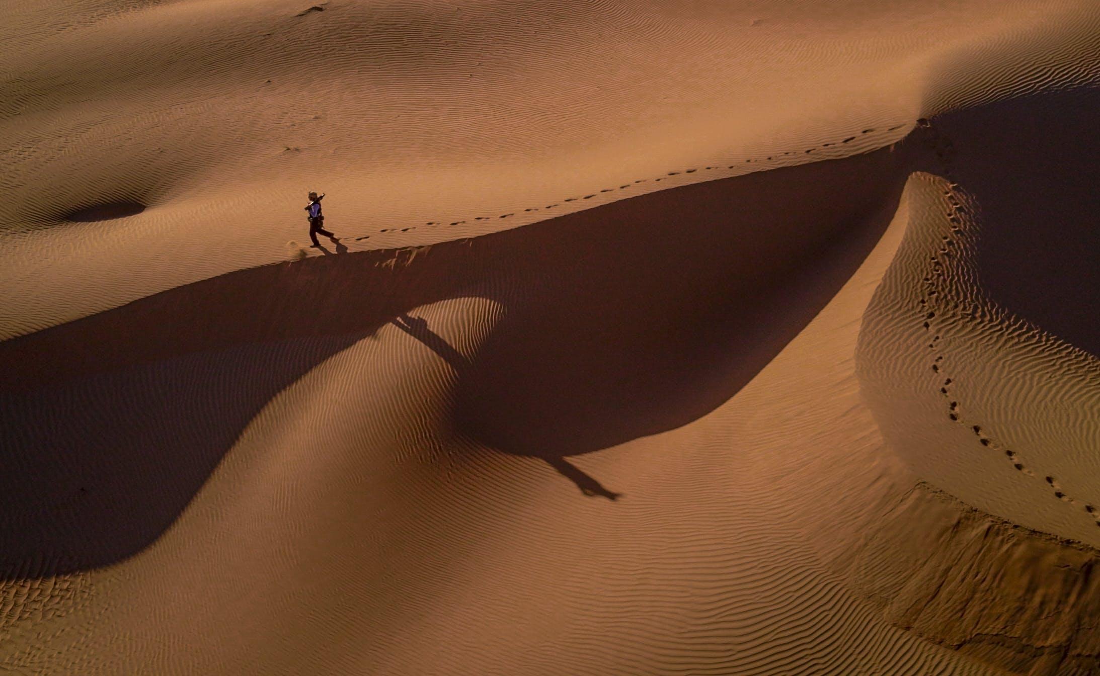 Person Walking on Desert