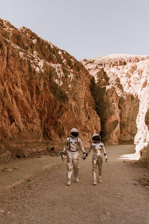 Astronauts Walking in a Planet