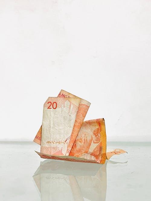 Foto profissional grátis de cédulas, dinheiro, grana