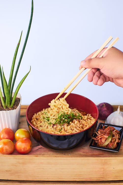 Person Holding Chopsticks