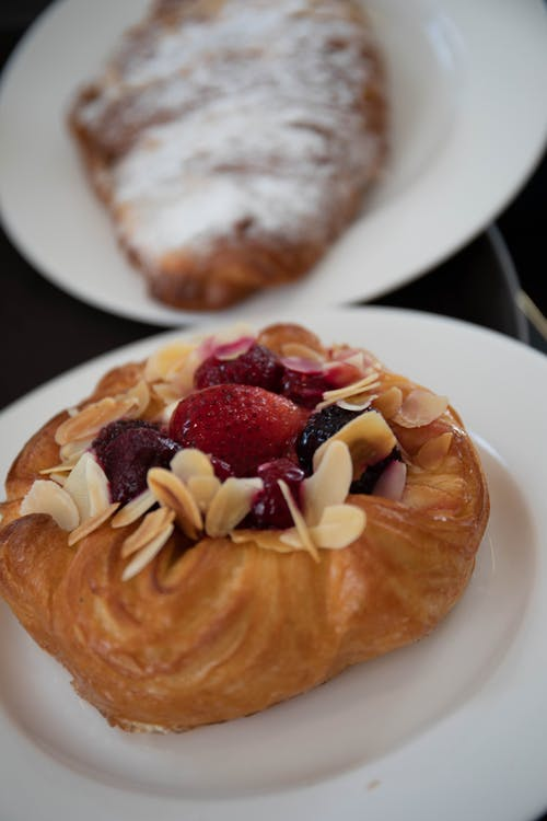 Pastry With Red Jam on a White Ceramic Plate