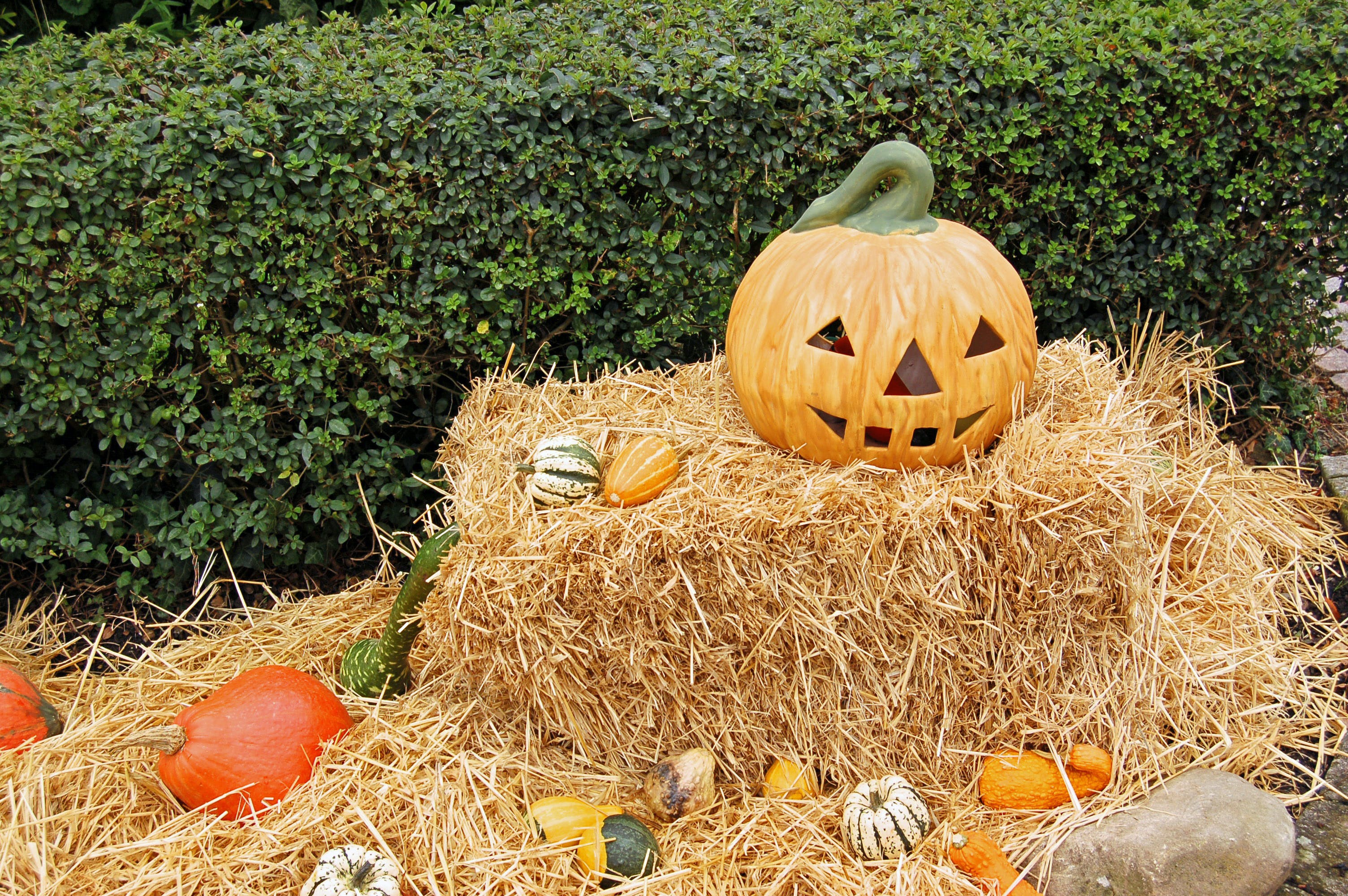 Jack-o'-lantern on Hay Stack during Day
