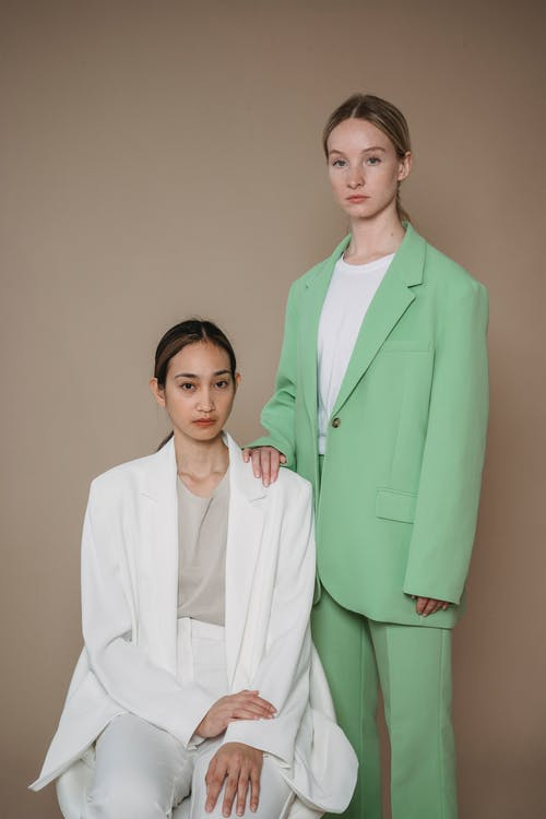 Woman in Green Business Suit Standing