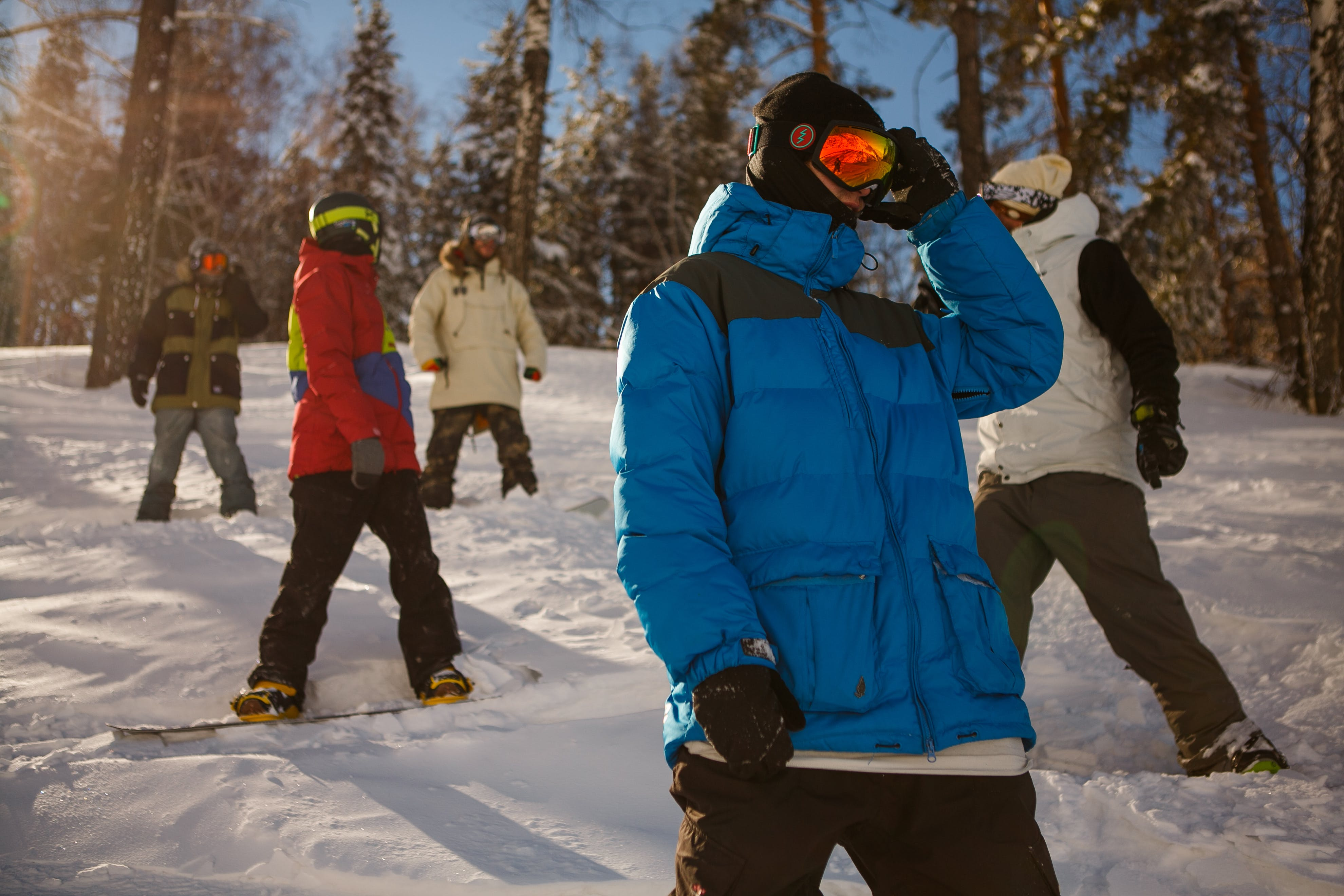 Group of People in Bubble Jackets Skiing in Mountain