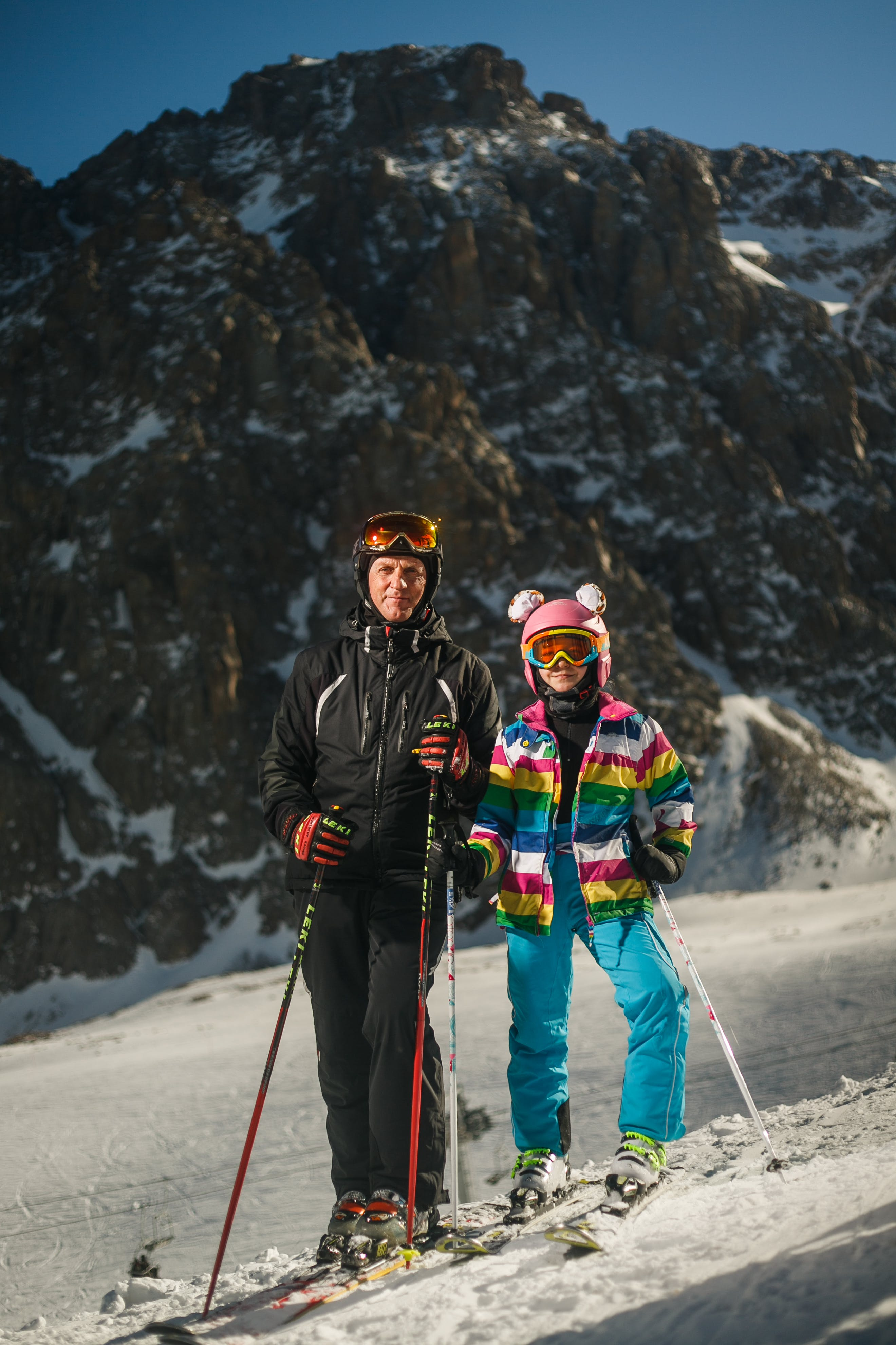 Man and Woman Wearing Snow Ski Suit and Snow Ski With Poles during Snow