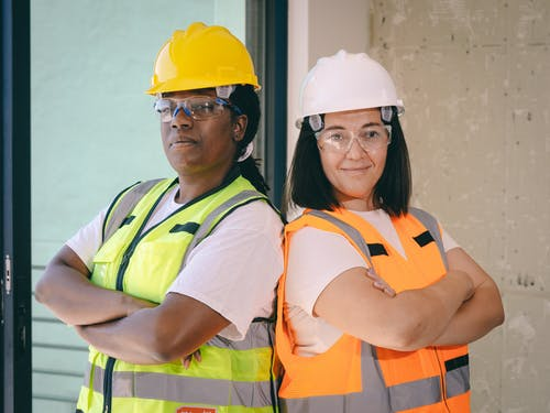 Female Engineers Standing Back to Back