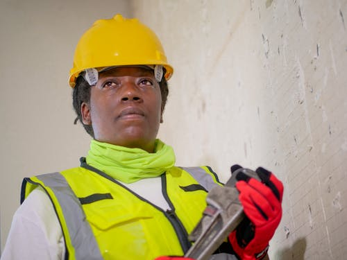 Handywoman Holding a Plumbers Wrench