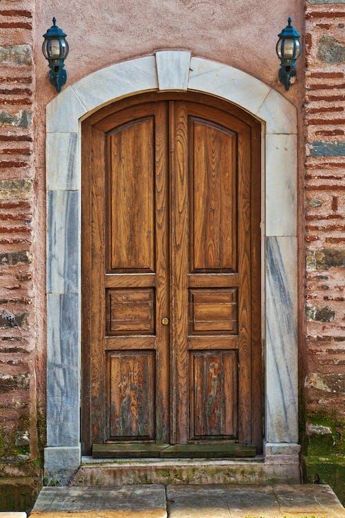 Brown Wooden Door on Concrete Wall
