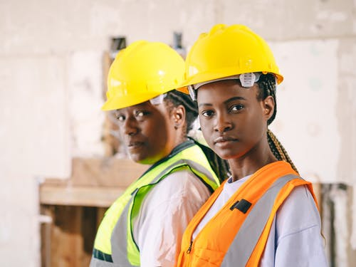 Women in Yellow Hardhat and Reflective Vest
