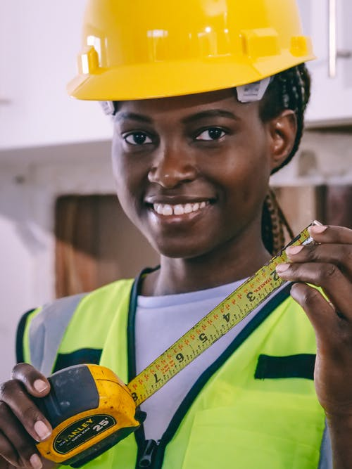 Close Up Photo of Woman Holding Measuring Tape