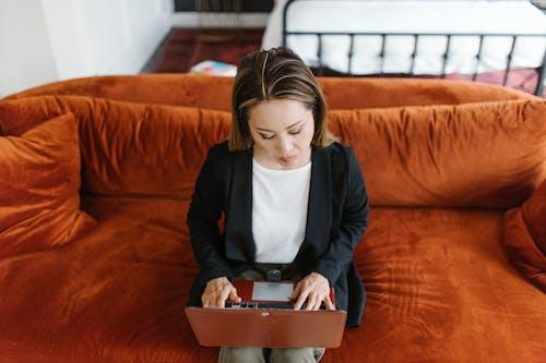 Woman Sitting on an Orange Ciuch