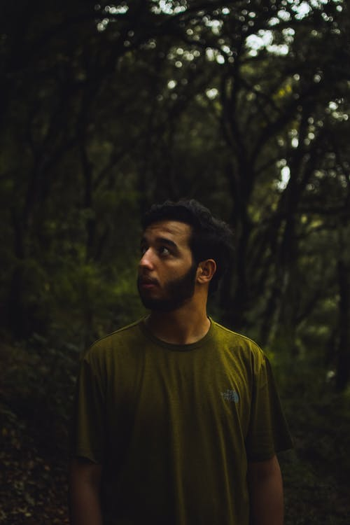 Man in Green Crew Neck Shirt Standing in Forest